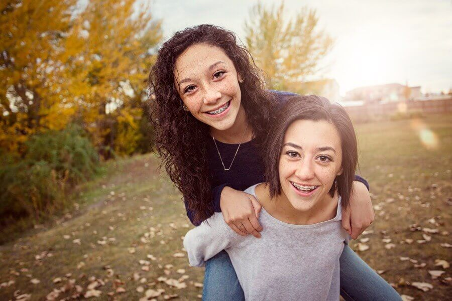 braces for teens - sisters hanging out