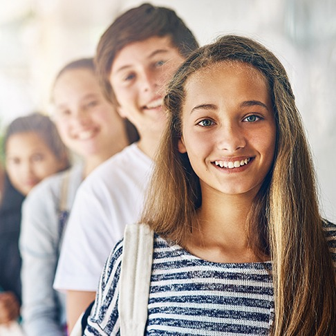 young girl with classmates