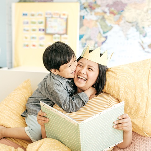 mother and young son reading together